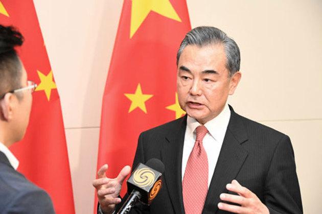 王毅:美国动用国家力量无端打压华为是典型的经济霸凌行为